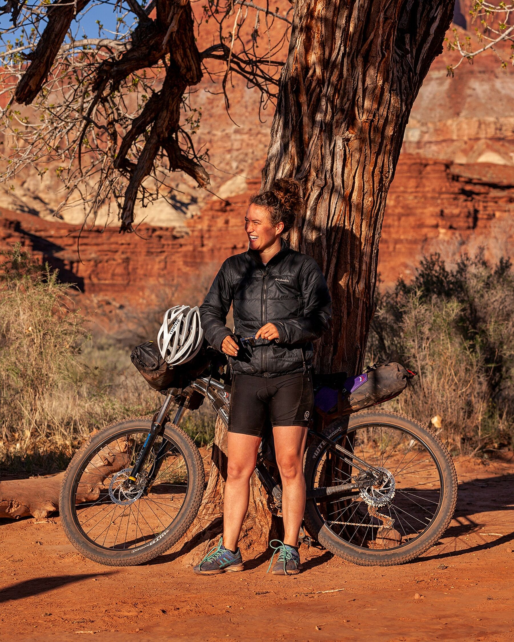 Lydia with her mountain Bike on the White Rim Trail in Canyonlands National Park, Utah