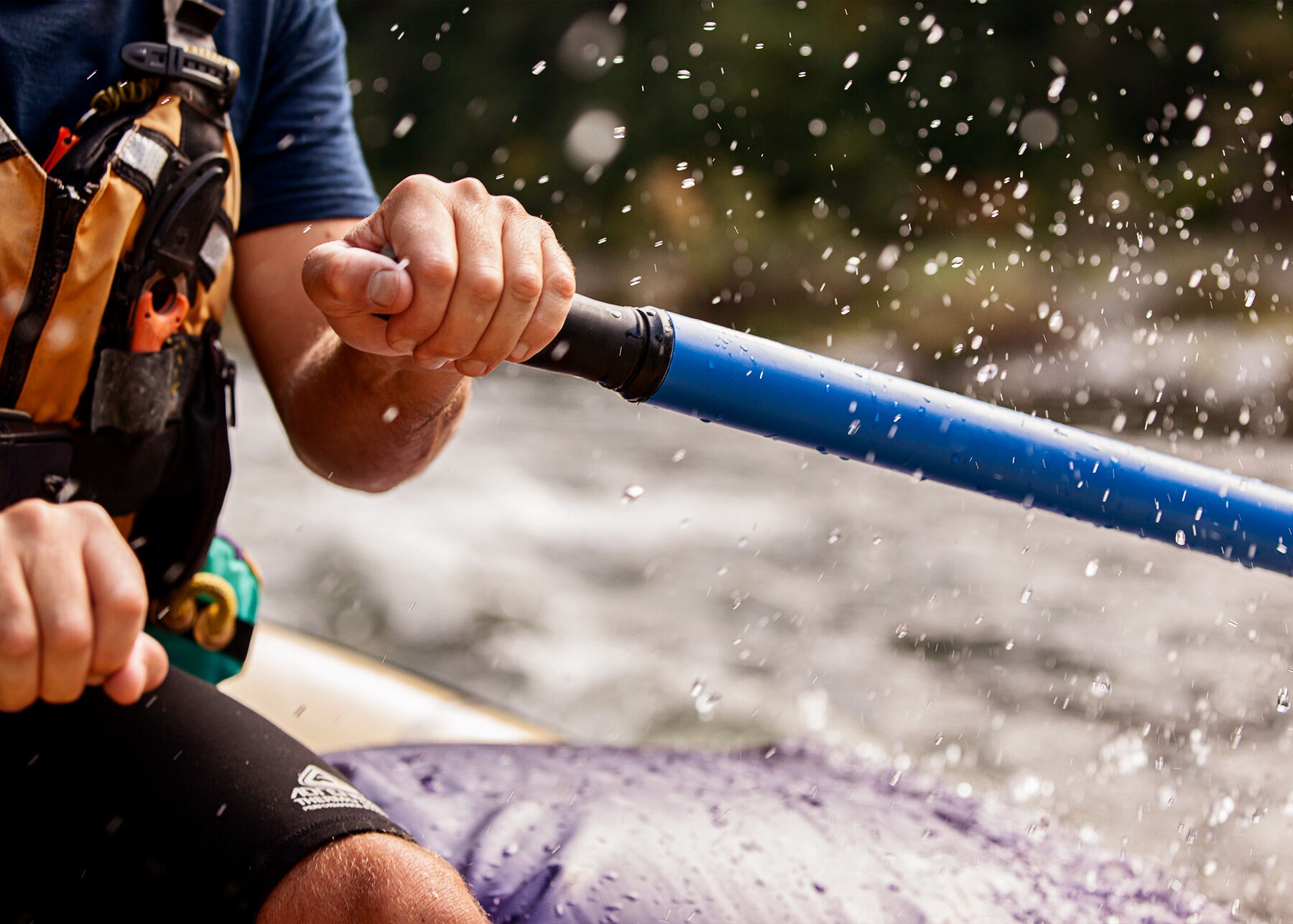 Detail of Danial operating rafting oars on Rogue River, Oregon